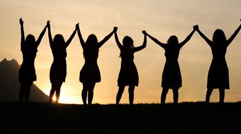 women-holding-hands_600w